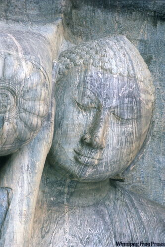Image of a serene Buddha carved from one block of granite in the long-ago capital city of Polonnaruwa.