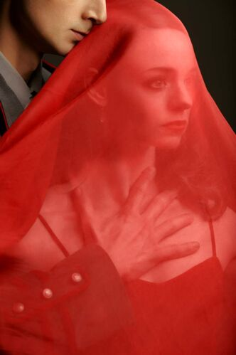 RWB dancers Jo-Ann Sundermeier and Alexander Gamayunov pose as characters from Margaret Atwood's The Handmaid's Tale.