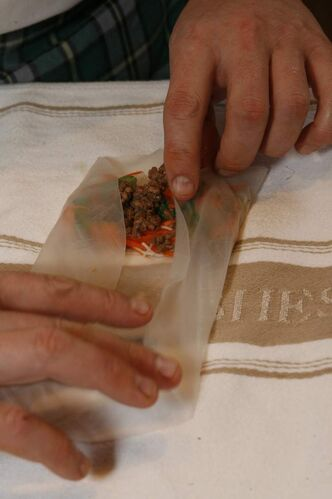 Assembling spring rolls with rice paper.