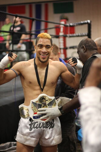 July 24 -- Muay thai fighter smiles after winning a bout. (SUPPLIED PHOTO) METRO