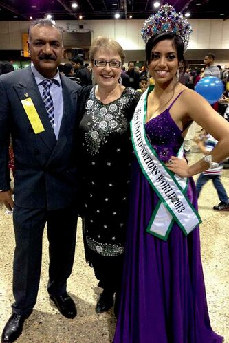 Burrows MLA Melanie Wight (centre), Surinder Goyal (left), and Nisansala Wijewardena, Miss United Nations World 2013, at the Diwali celebration hosted by the Hindu Society of Manitoba.