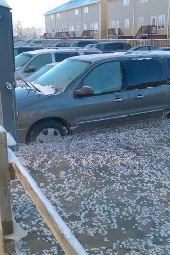 Vehicles were trapped in ice in the south parking lot of the Northwood Oaks apartments on Jefferson Avenue.
