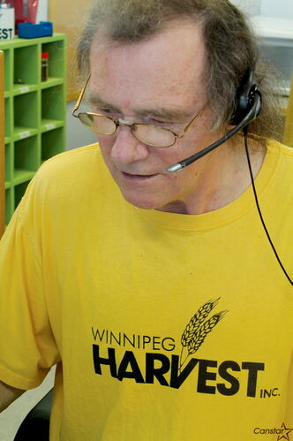 Dave Mouland, working the Winnipeg Harvest call centre, is slated to get an award for his years of volunteering.