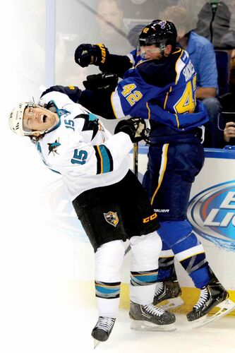 St. Louis Blues� David Backes (42) checks San Jose Sharks� James Sheppard (15) during the second period of an NHL hockey game Tuesday, Oct. 15, 2013, in St. Louis. (AP Photo/Bill Boyce)
