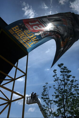 A massive banner unveiled for the annual Sizzling Summer Showdown ran into some opposition from high winds Tuesday.