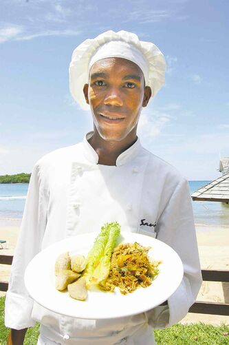 Chef Lorenzo Jones shows off St. Lucia�s national dish � salt fish with green fig and plantain � at Sandals Halcyon Beach Resort.