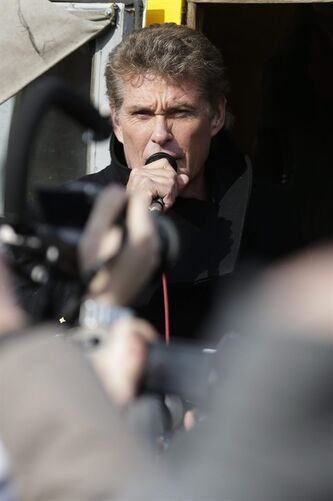 US actor David Hasselhoff speaks to the crowed from a truck as he attends a protest against the removal of a section of the East Side Gallery, a historic part of the former Berlin Wall, in Berlin, Sunday, March 17, 2013. Hasselhoff is fondly remembered by many Germans for releasing a song called