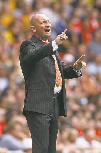 Blackpool's manager Ian Holloway reacts as he watches his team play against Arsenal during their English Premier League soccer match at Emirates Stadium in London, Saturday, Aug. 21, 2010. (AP Photo/Sang Tan) ** NO INTERNET/MOBILE USAGE WITHOUT FOOTBALL ASSOCIATION PREMIER LEAGUE (FAPL) LICENCE - CALL +44 (0)20 7864 9121 or EMAIL info@football-dataco.com FOR DETAILS **