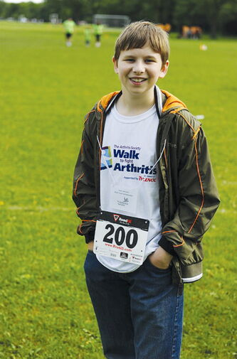 Youth ambassador Colin Johnson, seen here at the 2012 Walk to Fight Arthritis, and his family will be back for the 2013 walk.