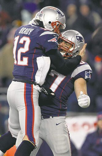 Patriots QB Tom Brady (12) celebrates TD with tight end Rob Gronkowski.