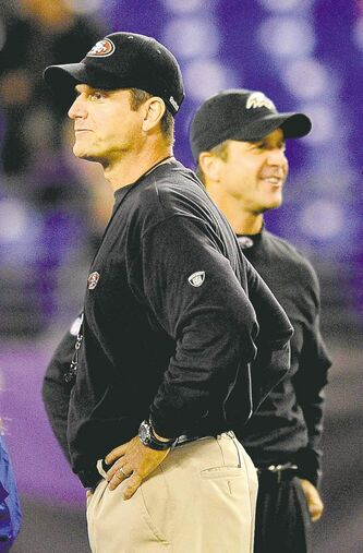 San Fran head coach Jim Harbaugh (foreground) went head to head with his brother, Ravens boss John Harbaugh, and lost on Nov. 24, 2011. Who will win this time?