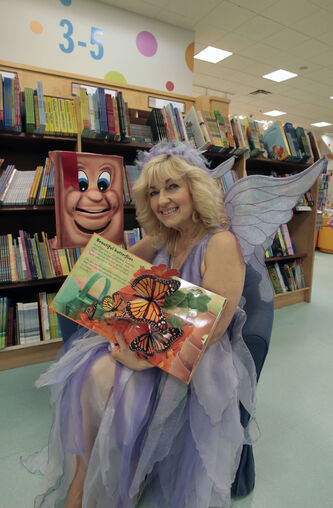 Cindy Robin, the Story Fairy  with her puppet 'Book'. She reads to sick kids.