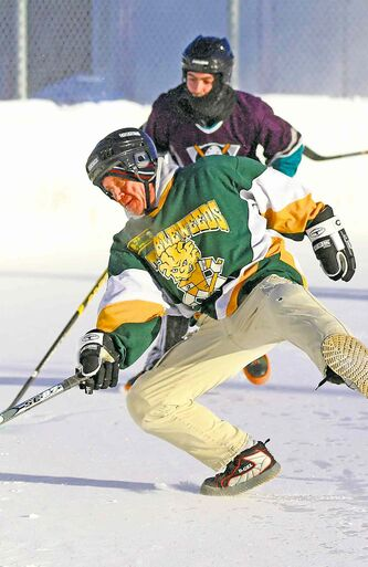 Colin Mackenzie of the Tumbleweeds, loses his footing while playing against the Mighty Puckin Drunks during a spongee game at Melrose Community Centre, Saturday, Wednesday, January 4, 2014. The Tumbleweeds are the oldest spongee team in the world.