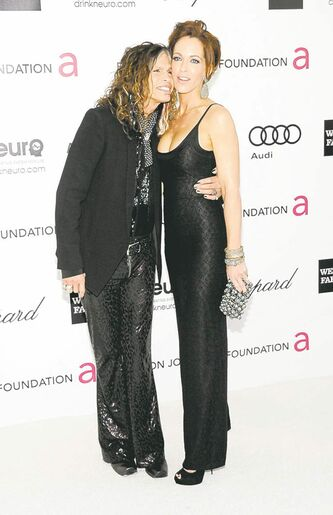 Steven Tyler and Erin Brady arrive at the Elton John AIDS Foundation Academy Awards viewing party in West Hollywood, Calif. on Sunday, Feb. 26, 2012. (AP Photo/Dan Steinberg)