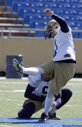 Bomber hopeful Justin Palardy kicks a field goal in practice Monday.