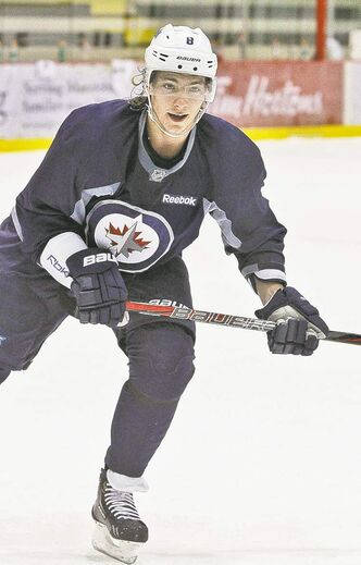 mike deal / winnipeg free press archives Jets centre Alex Burmistrov would probably rather be playing in Russia, but he's taking his AHL assignment in stride.
