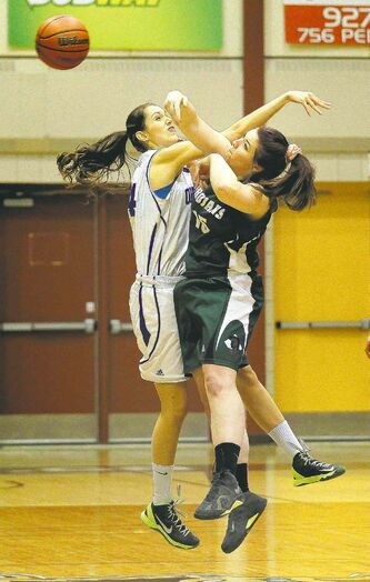 Oak Park's Shawn Pallister (left) battles Massey's Katie Ivey for possession.