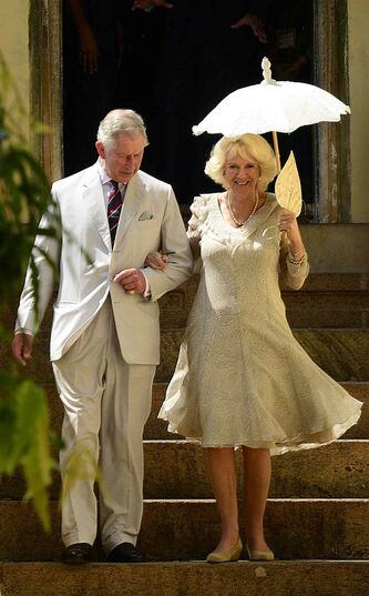 Prince Charles and his wife Camilla, the Duchess of Cornwall, walk out of the Mattancherry Palace, where historical artifacts are showcased, in Kochi, India, last November.