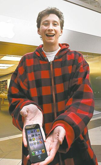 Bradley Lacroix is one of the first to get his new iPhone 5. He said he feels 'like a better person.'