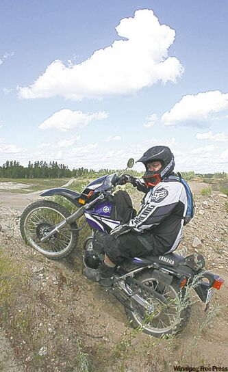 Doug Bourbonniere prefers two wheels but still tears up the dirt.