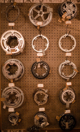 Used gear wheels on display at Natural Cycle in the Exchange District.