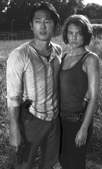 "Steven Yeun and Lauren Cohan star on AMC's ""The Walking Dead."""
