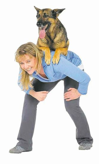 Babette Haggerty (with her buddy Steve) is a veteran dog trainer.