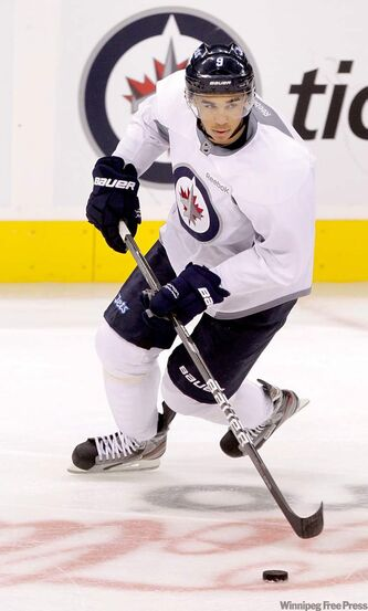 Evander Kane at practice in the MTS Centre Tuesday. Kane rode the pine for most of Sunday's opening game.