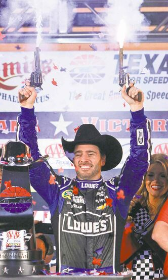 Jimmie Johnson celebrates the way you can only do in Texas, by shooting something.