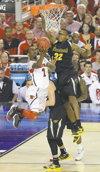 Louisville guard Russ Smith (2) shoots against Wichita State guard Carl Hall (22) in Saturday's semi.