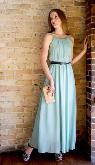 Model Akosua  Knowles is wearing a mint green Maxi dress (Angel Eye, $104.99), a navy bowlbelt (Joia Accessories, $19.99) and striped clogs (Miss L-Fire, $169.99) from Out of the Blue. She is carrying a cream clutch wallet (Vero Moda, $19).