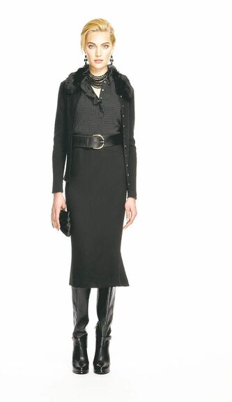Black faux fur-collar sweater-jacket paired with a woven fluted pencil skirt.