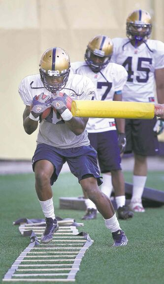 RB Paris Cotton handles two balls while being distracted with the stick Wednesday.