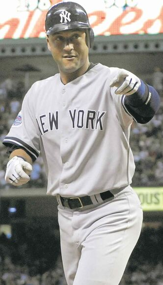 New York Yankees' Derek Jeter points toward the crowd as he heads to the dugout after hitting a solo homer in the eighth inning against the Houston Astros in a baseball game Friday, June 13, 2008, in Houston. The Yankees won 2-1. (AP Photo/Pat Sullivan) closecut close cut