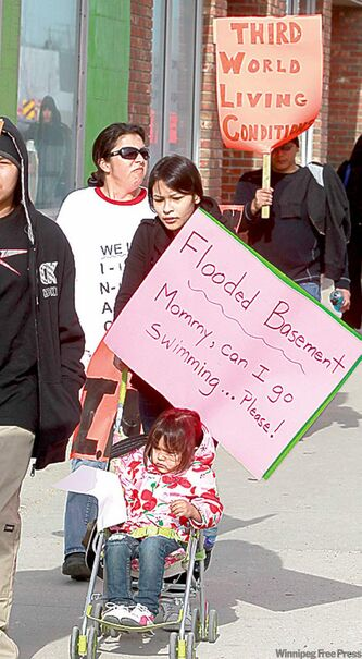 Lake St. Martin First Nation members protest on Notre Dame Avenue Tuesday.