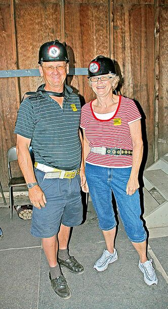 This couple visited the historical Atlas Coal mine in Alberta as part of a summer vacation.