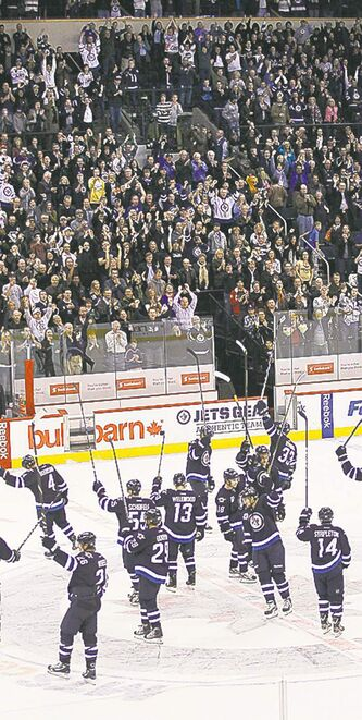 Winnipeg Jets salute fans after giving them their first win against the Pittsburgh Penguins at the MTS Centre on Oct. 17, 2011/
