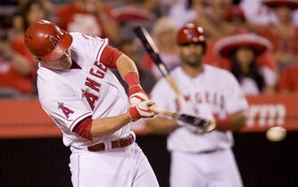 The Angels' Mike Trout singles to left in the first inning against the Seattle Mariners Tuesday Sept. 16, 2014. (AP Photo/The Orange County Register, Paul Rodriguez)