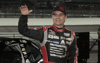 FILE - In this Nov. 14, 2014, file photo, Jeff Gordon celebrates after qualifying laps for the EcoBoost 400 auto race in Homestead, Fla. Gordon says he will retire as a full-time driver after the 2015 season. (AP Photo/Darryl Graham, File)