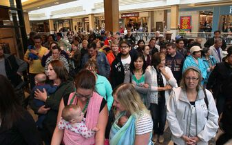 Crowds line up for the new retailers just before Polo Park Shopping Centre opened their $49-million redevelopment.