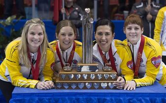 Manitoba skip Jennifer Jones, left to right, third Kaitlyn Lawes, second Jill Officer and lead Dawn McEwen celebrate their win in the gold medal game against Alberta at the Scotties Tournament of Hearts in Moose Jaw, Sask. Sunday, Feb. 22, 2015. THE CANADIAN PRESS/Jonathan Hayward