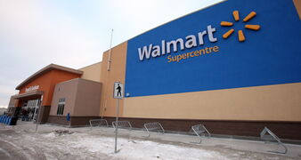 Workers are putting the finishing touches on the Walmart Supercentre on Taylor Avenue. The store opens Thursday.