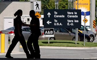Canadian border guards are silhouetted as they replace each other at an inspection booth at the Douglas border crossing on the Canada-USA border in Surrey, B.C., August 20, 2009. Ambassador Gary Doer and other embassy staff will make it a priority over the coming days to reach out to American decision-makers to emphasize Canada's commitment to border security, a government source said Thursday. THE CANADIAN PRESS/Darryl Dyck