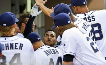 San Diego Padres' Alexi Amarista celebrates with teammates after his solo home run during the second inning against the Philadelphia Phillies in a baseball game Thursday, Sept. 18, 2014, in San Diego. (AP Photo/Don Boomer)