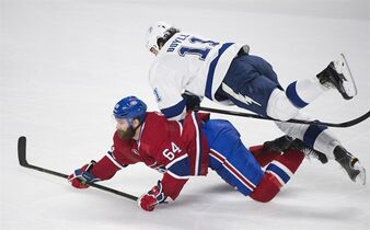 Tampa Bay Lightning's Brian Boyle (11) collides with Montreal Canadiens' Greg Pateryn during third period of Game 1 NHL second round playoff hockey action in Montreal, Friday, May 1, 2015. THE CANADIAN PRESS/Graham Hughes