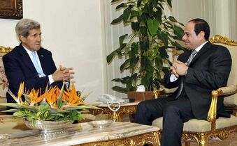 In this photo provided by Egypt's state news agency MENA, U.S. Secretary of State John Kerry, left, meets with Egyptian President Abdel-Fattah el-Sissi at the presidential palace in Cairo, Egypt, Monday, Oct. 13, 2014.