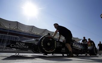 The Force India Formula One team pushes a car down pit lane for the Formula One U.S. Grand Prix auto race at the Circuit of the Americas, Thursday, Oct. 30, 2014, in Austin, Texas. (AP Photo/Darron Cummings)