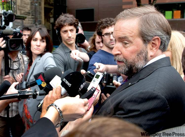 Quebec MP Thomas Mulcair, one of the NDP leadership favourites, hasn't said no to a possible merger.