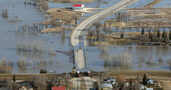 Highway 75 to the United States is often closed during spring flooding at the town of Morris. The province will raise the roadway and bridge to prevent closures.