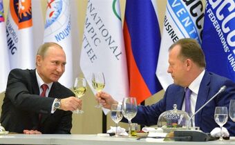 Russian President Vladimir Putin, left, toasts with Marius Vizer, head of IFJ and SportAccord Convention president, during a reception in Russian Black Sea resort of Sochi, Russia, Monday, April 20, 2015. (Alexei Druzhinin/RIA Novosti, Kremlin Pool Photo via AP)